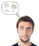 Young man looking up dreaming about beach Stock Photos
