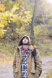 Young man looking up. In fall park during rain Royalty Free Stock Image