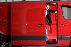 Young man looking through van door, portrait royalty free stock photo