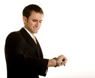 Young Man Looking at Watch Stock Photo