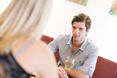 Young man looking at a woman on Royalty Free Stock Photography