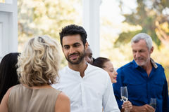 Young man looking at woman in bar. Handsome young men looking at women in bar Stock Images