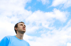 The young man looks at the blue sky Royalty Free Stock Image