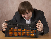 The young man  looks at a box Royalty Free Stock Photography