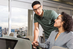 Young man looks at employee while she shows a project. royalty free stock photos