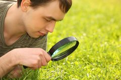 Free Young Man Looks Through Magnifier Stock Photo - 11411270