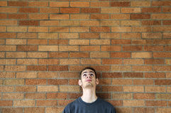 Young man looks up above stock photo