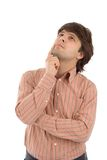 Young man looks upward. White background Stock Photo