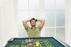 Young Man Losing At Roulette Table Royalty Free Stock Image
