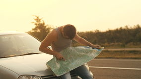 Traveling by Car Man Looking at the Map