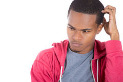 A young man lost in serious thoughts Stock Image