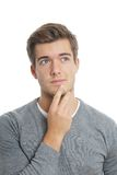 Young man lost in thought Royalty Free Stock Photo