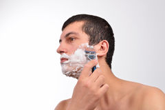 Young man with lots of shaving cream on his face prepar Royalty Free Stock Photos