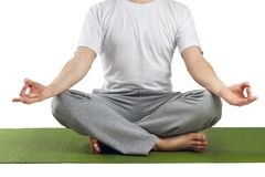 Young man in lotus pose Stock Photo