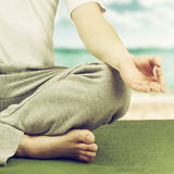 Young man in lotus pose. stock images