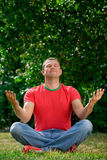 Young man  in lotus position Stock Photo