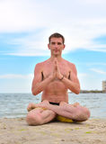 Young man in lotus position Royalty Free Stock Image