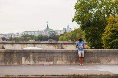 Young man lounges on Seine bridge, Paris Royalty Free Stock Photos