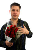 Young man in love is giving red roses. Isolated on white background Royalty Free Stock Image