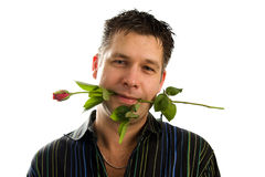 Young man in love with rose in mouth Royalty Free Stock Image