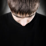 Young Man with lowered Head Stock Photo