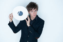 Young man with LP record Royalty Free Stock Photography