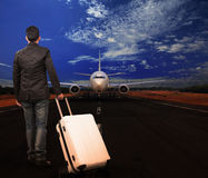 Young man and luggage on airport runways Royalty Free Stock Images