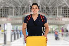 Young man with luggage baggage airport bag flying travel traveli. Ng vacation holidays fly Royalty Free Stock Photography