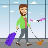 Young man with luggage and dog waiting airplane in the airport waiting room Royalty Free Stock Images