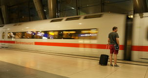 Young man with luggage get onboard to fast ICE train timelapse, stock video footage
