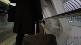 Young man with luggage, moving on magnetic tape at airport indoor. stock video