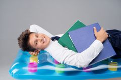 Young man lying on air-bed Royalty Free Stock Photography