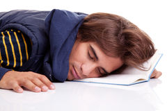 Young man lying asleep on a book Stock Images