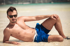 Young man lying on the beach Royalty Free Stock Photos