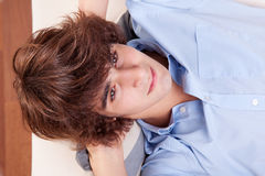 Young man, lying on the couch Royalty Free Stock Photography