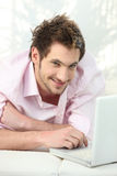 Young man lying on couch Stock Image