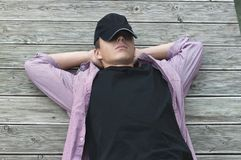 Young man has a rest lying on the boards Royalty Free Stock Photos