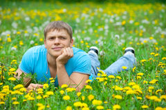 Young man lying on the grass Stock Image