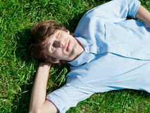 Young man lying on grass Stock Image