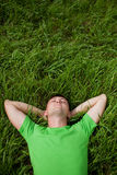 Young man lying on the grass Stock Photos