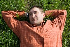 Young man lying on the grass Royalty Free Stock Photo