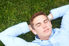 Young man lying in grass Royalty Free Stock Images