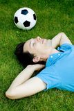 Young man lying on the grass Royalty Free Stock Photography