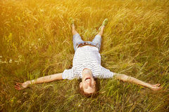 Young man lying in the grass Stock Photography