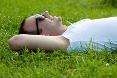 Young man lying on the grass Royalty Free Stock Image