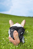 Young man lying on grass in park Stock Photo