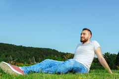 Young man lying on the grass in park Royalty Free Stock Images