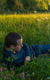 Young Man Lying in Grass Royalty Free Stock Image