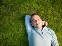 Young man lying on green moss Royalty Free Stock Photography
