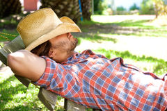 Young man lying on hammock resting with hat Royalty Free Stock Photography